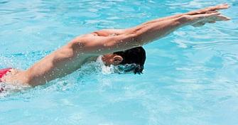 Man Swimming Butterfly Stroke
